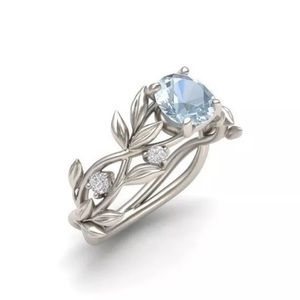 Silver Winding Vine Blue Crystal Ring